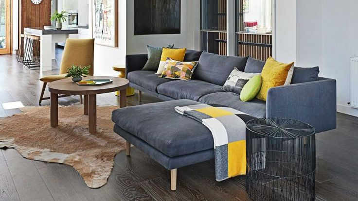 cosy-living-room-grey-couch-cushions-animal-skin-rug-july14