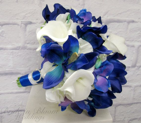 These Blue orchid calla lily  are soft to touch and look so real on this custom wedding bouquet by BrideinBloomWeddings