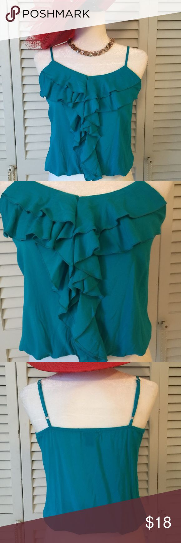 "Body Central strappy Top Size Small Cute little Strappy top with ruffles at beck and down front.  Turquoise color.  Straps are adjustable.  Elastic waist.  Bust is 34"" and length from edge of straps to hem elastic is 18"".  Fabric is 100% rayon. Body Central Tops Crop Tops"