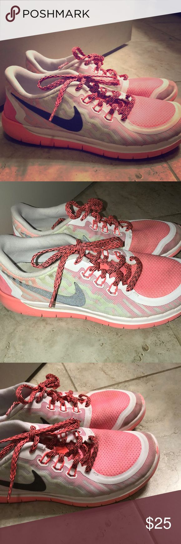 Nike Free Runs Gently used. Great condition. slight wear on front of shoe but not noticeable. Pink and green with Black nike but with flash the nike turns a metallic silver color. Nike Shoes Sneakers