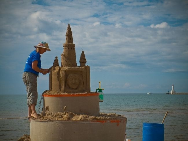 "Master sculptor Sandi ""Castle"" Stirling of Hamilton creates another work of sand art on Cobourg Beach. (Photo by Stephen Della Casa)"
