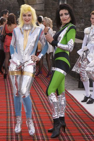 Glam Space Age - Punk Rock Queens, designer Pam Hogg and Siouxsie rock the tartan carpet.