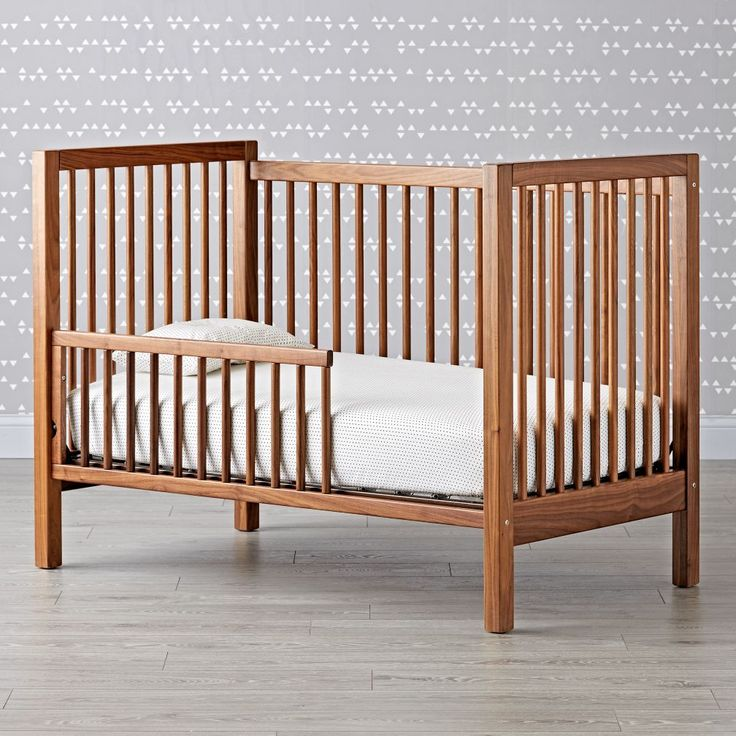 Shop Andersen Crib Toddler Rail (Walnut).  This safe, sturdy toddler rail was designed to coordinate with our Anderson Crib.  The rail allows the crib to easily convert into a toddler bed and grow with your little one.