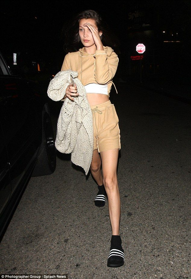 Casual chic: Arriving in a casual-chic beige ensemble, Bella sported matching shorts and a...