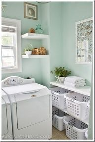 Love the wall color!  Paint color is Rainwashed by Sherwin Williams. I absolutely LOVE it!!  Nice redo on this laundry room.. Baskets could be labeled with each family members name and they can pick up and put away their own clothes!