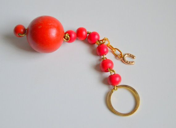 An impressive 2015 Good Luck #Key Chain to put your  home or #car keys.. It is made from  wooden beads.  From a metal gold  ring ,hanged a big wooden ball bead and  fuchsia... #keychain #brelock #keys #house #key #holder #holidays #christmas #ornament #decoration