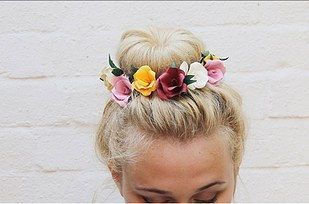 Use these DIY paper flowers to make a topknot or side braid festival-ready. | 31 Pretty Hair Accessories You Can Actually Make