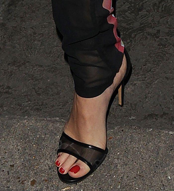 rita ora sandals   Rita Ora Pairs adidas Skeleton Track Suit with Casadei Heels