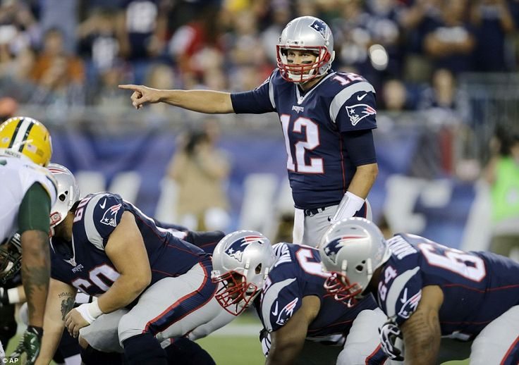 Brady  sets his team at the line of scrimmage in the first half of the NFL preseason game