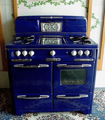 a reconditioned vintage gas stove in cobalt blue or british racing green