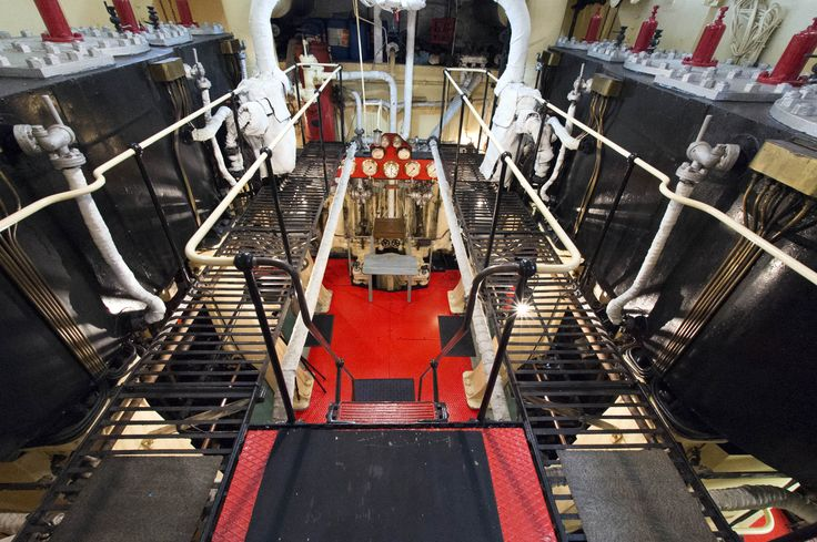 View of the twin compound triple-expansion steam engines from the gallery level of the engine room aboard the historic steam tug William C. Daldy