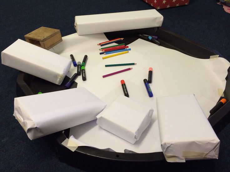 Fun mark making opportunity / Early Years - wrap up blocks with drawing paper for an alternative to flat paper. Watch then get creative making parcels, decorating them and writing their name :)