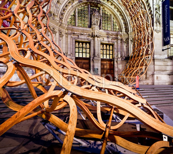 Timber Wave installation at the Cromwell Road entrance to the Victoria and Albert Museum, South Kensington, London, at dusk. Amanda Levete Architects