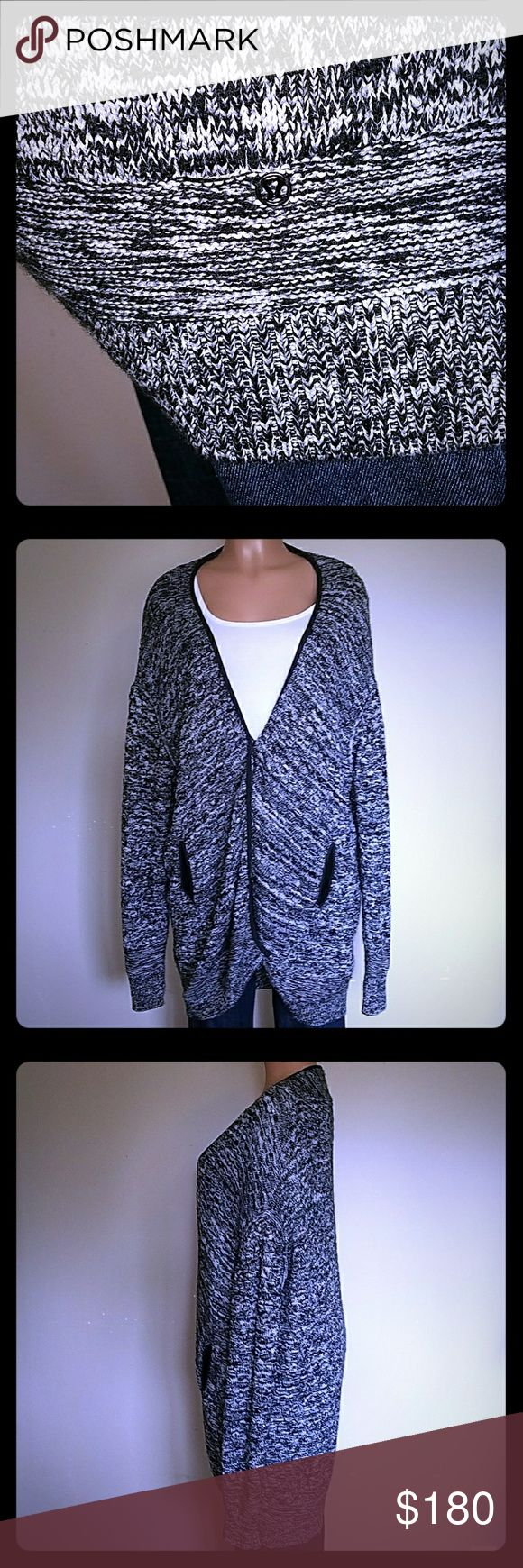 ❤RARE❤ lululemon Long Cardigan Sweater Sz 8 AWESOME lululemon Long Cardigan Sweater Size: 8 (But is oversized and would fit a 10/12, made to be big) Color: Heathered Gray/Black/White Snap front Side pockets lululemon athletica Sweaters Cardigans