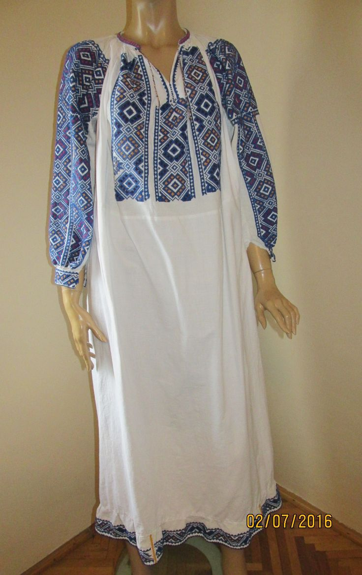 Gorgeous 50 - 60 years old Romanian traditional blouse dress from Muscel area. The dress is hand embroidered with blue, red and yellow cotton thread on white commercial linen. At www.greatblouses.com