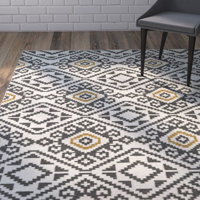 Anchor your dining set or living room seating group in chic style with this flatweave wool rug, showcasing a Southwestern motif for eye-catching appeal.