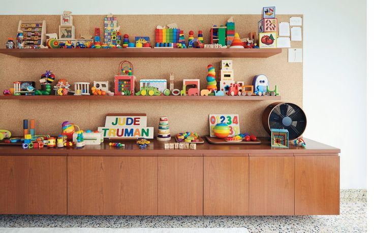 My favorite nursery thus yet! I LOVE all the wood toys and that each toy is so colorful in this very neutral room!