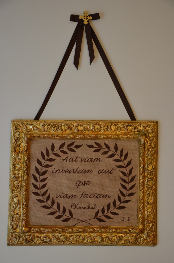 An old frame covered with gold leaf, cheap fabric, acrylic colors and a famous saying...