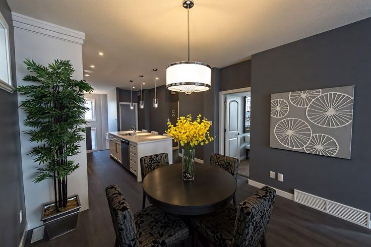 Dining area with sleek, modern light fixture #homedecor #buildwithharmony #liveinharmony