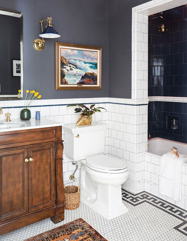 In this bathroom by designer Stefani Stein, the warm wood vanity and rug nod to each other nicely.