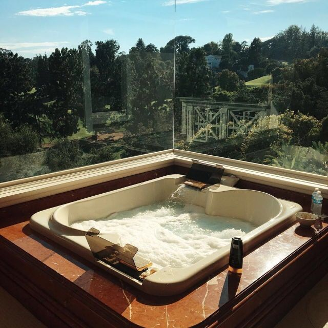 Perfect bathtub with a kick ass view too! This looks relaxing and romantic!