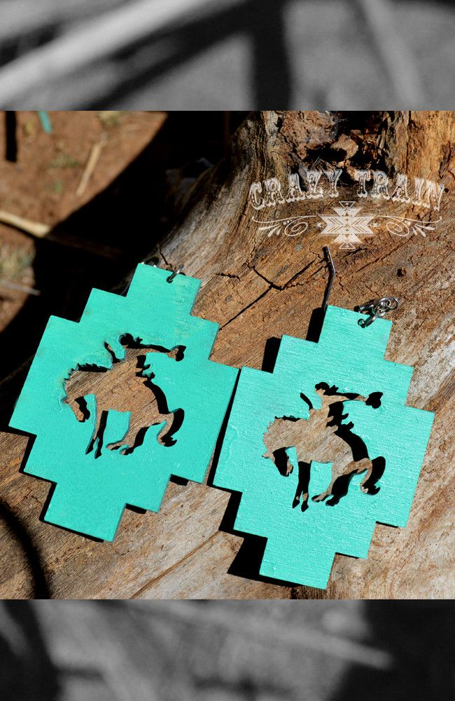 Bodacious and beautiful! Words can't describe how totally awesome these new earrings from Crazy Train are! Made of a light wood, these large turquoise earrings have a geometric southwest shape and boa