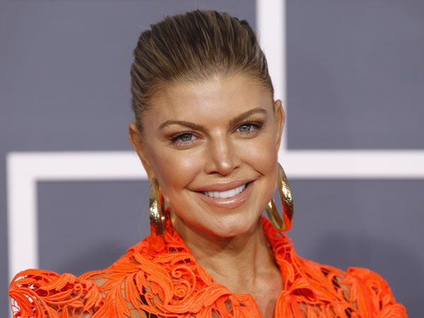 Fergie, the female vocalist of the famous and talented hip hop group Black Eyed Peas celebrates her 38th birthday today. The sexy and stunning singer has been part of the group since 2002 and has done magic with her sultry voice. In 2006, Fergie released her first single album which included smashing tracks such as Fergalicious and London Bridge. On her birthday today, we bring you some our favourite tracks from the band and her single album. Check them out.