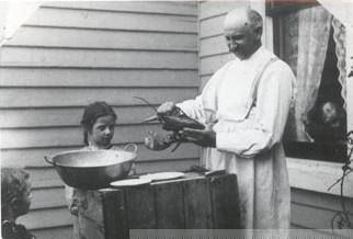 Professor H.R. Playtner preparing lobster while Jerry Smith's daughter's watch. Prof. Playtner was Jerry Smith's horology professor. How would you #CaptionThis Photo?