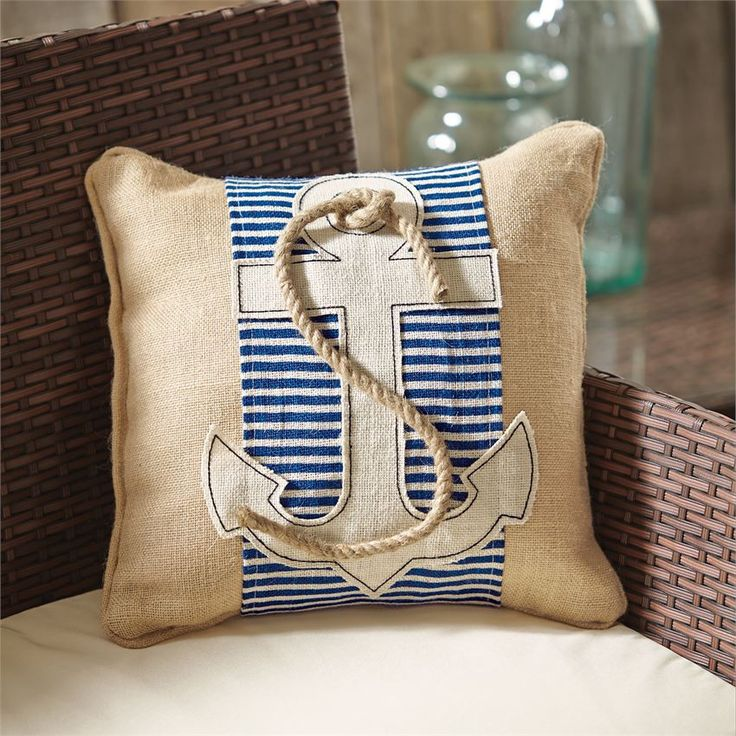 *** FREE SHIPPING OVER $100 for qualifying orders (see below) Vertical white burlap pillow wrap features printed background pattern with contrasting anchor applique and knotted rope detail. Secures wi