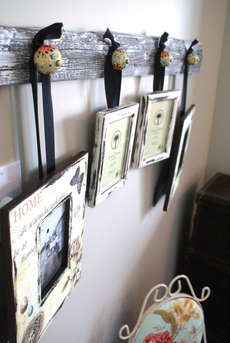 Cute idea for hanging photos. add knobs to a piece of old barn wood, and hang pictures with ribbons