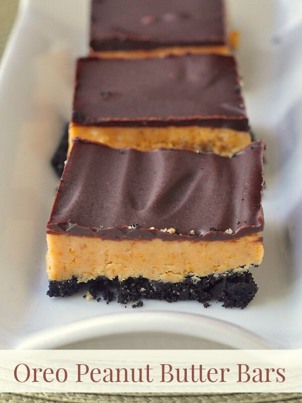 Oreo Peanut Butter Bars - the luscious taste of a peanut butter cup with the added crunch of an Oreo crumb crust. Great for Christmas cookie exchanges too!