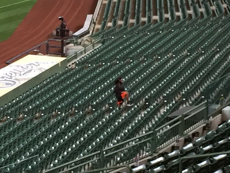 Twelve hours after earning a win in his Giants debut, Johnny Cueto runs and high-steps the stairs in the lower deck at Miller Park on Wednesday. Photo: Henry Schulman