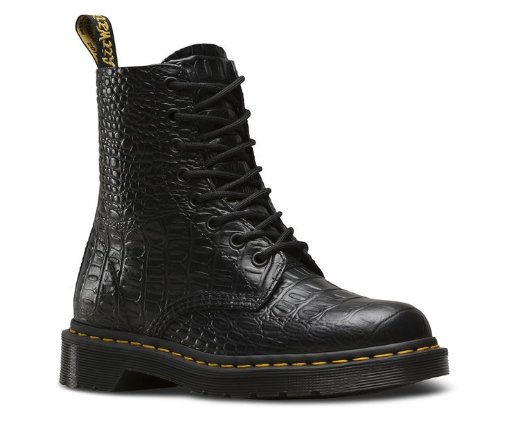 With its strong 8-eye silhouette and low-key, working class style, the Pascal epitomizes the earliest offerings produced by Dr. Martens in the 1960s — and embraced by youth culture from Liverpool to San Francisco. This season, a shiny leather embossed with a faux crocodile print brings a next-level luxury and classic English feel to the classic boot. Made with New Vibrance Croco, a shiny leather embossed with a faux crocodile print Serves up all the traditional Doc's DNA, like grooved edg...