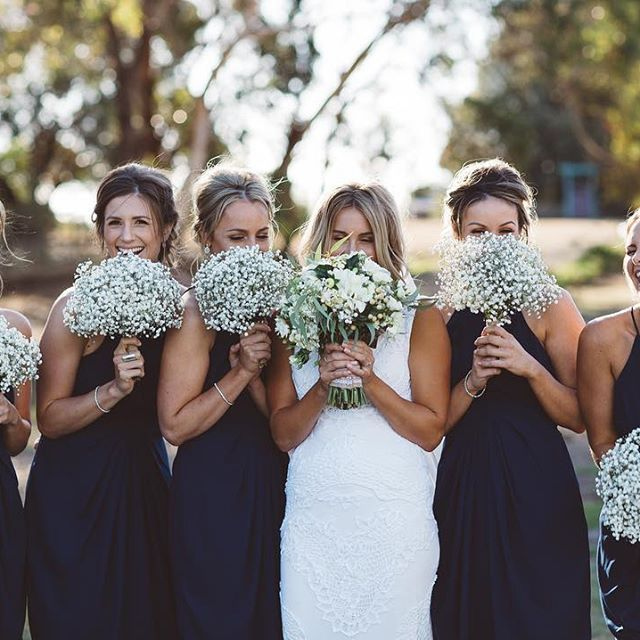 Phillip Island Wedding. Bride wears Jane Hill Lottie gown. Navy Bridesmaids dresses. Baby's breath bouquets. Image by Vanessa Norris Photography.