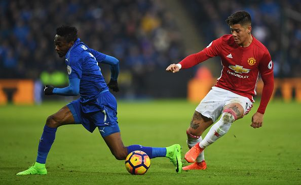 Marcos Rojo of Manchester United and Ahmed Musa of Leicester City battle for the ball during the Premier League match between Leicester City and...