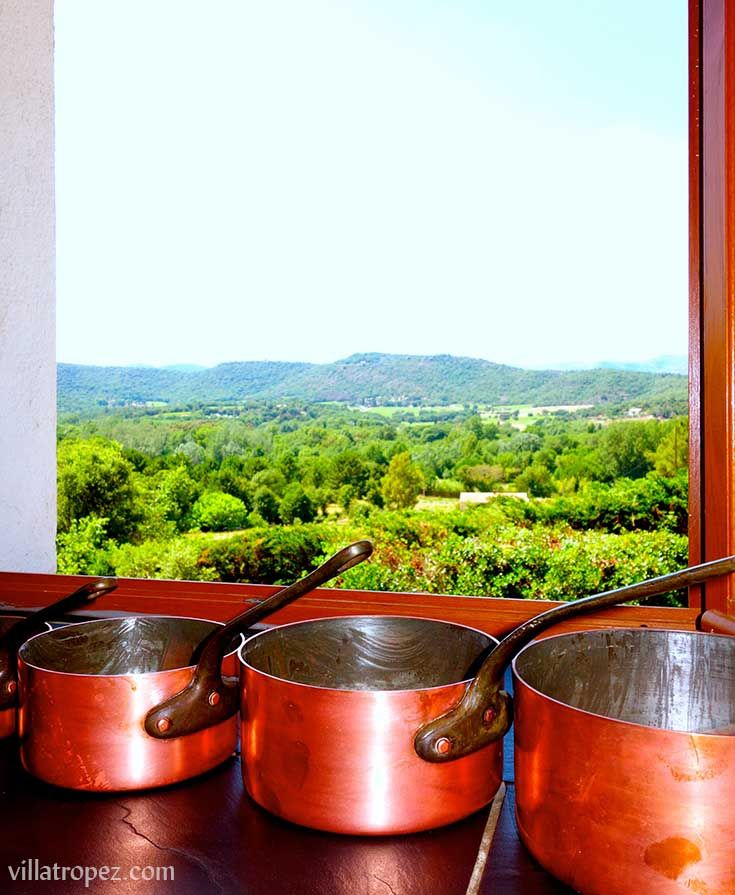 Traditional french copper saucepans lined up in a Provence farmhouse kitchen of a rental Villa in Provence, close to St Tropez. www.villatropez.com