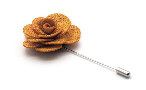 The Greco yellow handmade cotton lapel flower pin captures the essence of fragile beauty and nature in an accessory you can wear daily.