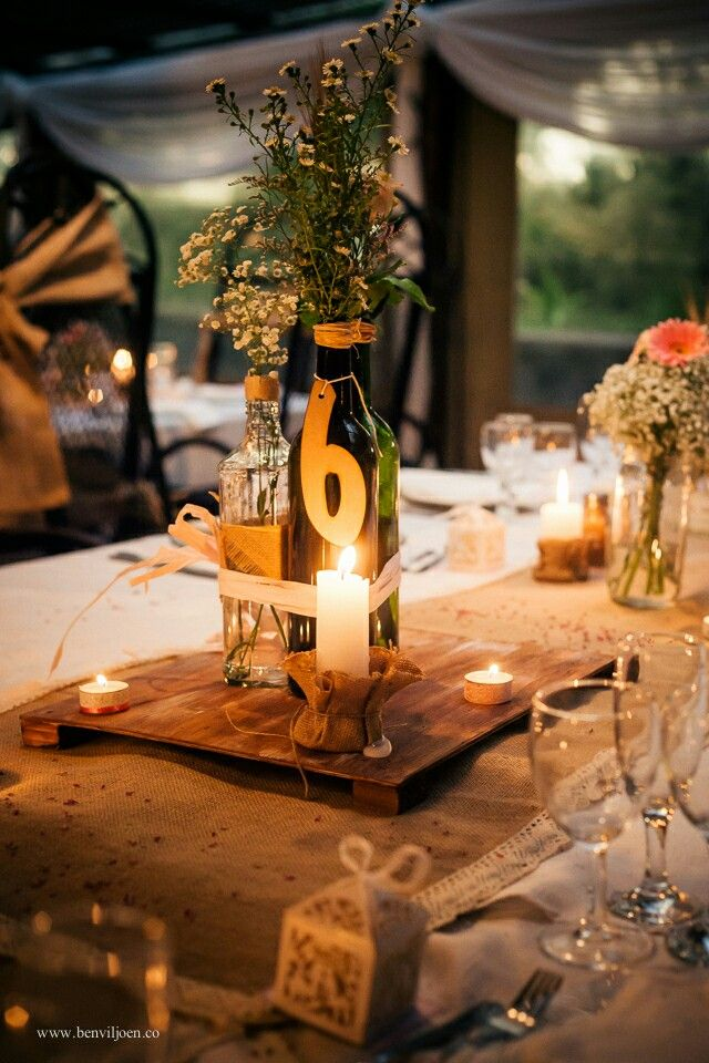 Rustic, wedding, centre piece, wine bottle, daisy, baby's breath, rose, wooden board, candles, burlap, table numbers, handmade