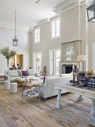 The large crown mouldings in this living room bring the cathedral ceilings into comprehensible perspective #plaster ~ also love the wood floors