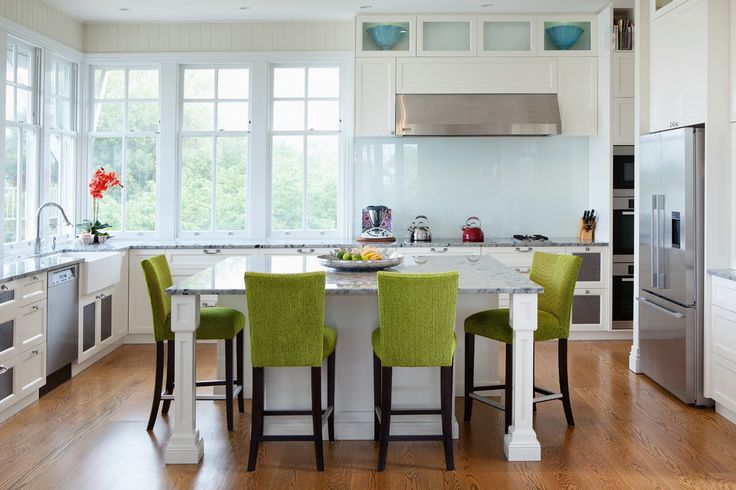 Beautiful kitchen in white 2pac featuring upholstered barstools in lime green Designers Guild fabric.
