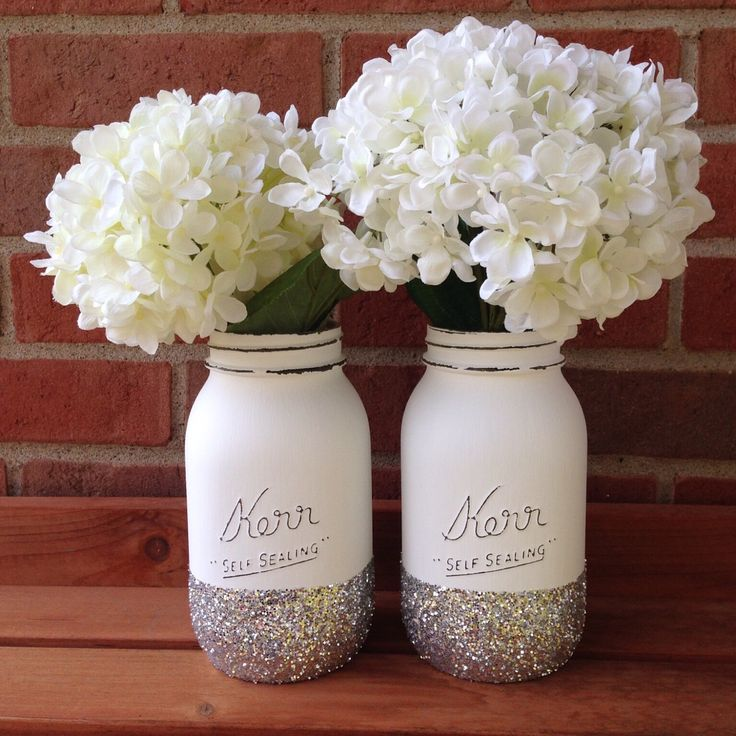 Glitter Mason jar, wedding mason jar, winter wedding, winter decor, silver glitter, spring mason jar, spring wedding, white wedding decor by shopcampcreate on Etsy https://www.etsy.com/listing/255007089/glitter-mason- jar-wedding-mason-jar I like but needs red flowers