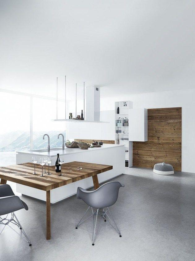 Cozinha branca clean moderna com piso de cimento queimado