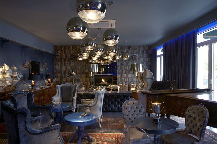 Boutique hotel | Lounge | Piano | Gold pendants | Books wallpaper | Bar | Etienne Hanekom Interiors
