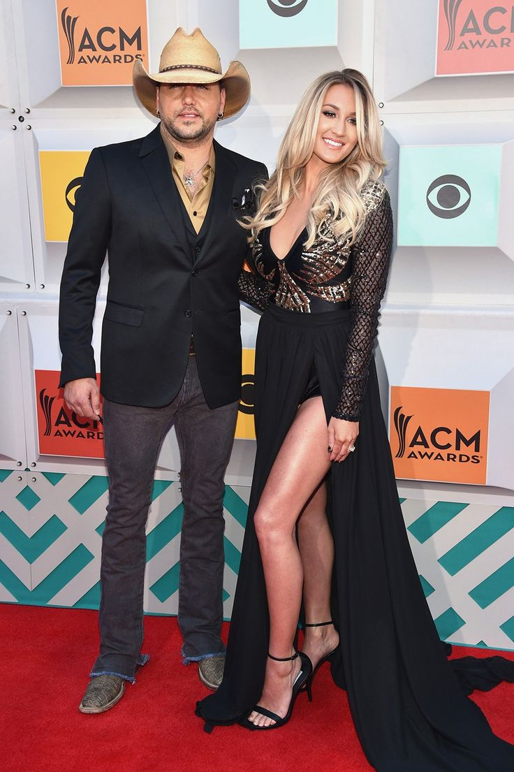 Jason Aldean & his mistress-turned-wife Brittany Kerr. I'm guessing she'll want to keep cheater Jason on a short leash & prob not be too thrilled if he wants to go clubbing with his buddies! LOL!!