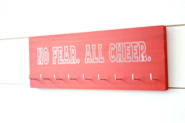 NO FEAR. ALL CHEER. (Love that little spirit flag in the R, don't you!) This item is pictured with solid red paint and unique font not shown on our list of choices. White lettering will be used as a d