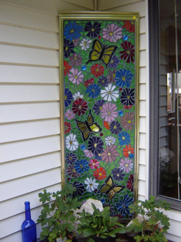 Mosaic from am old shower/tub door. How clever!