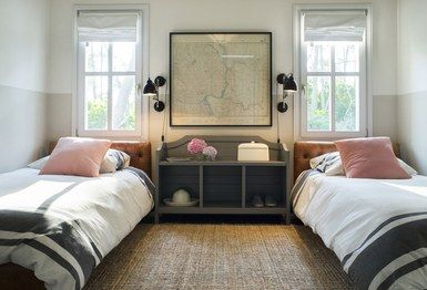 Galli furnished the guest bedroom with tufted-leather twin beds placed under parallel French windows. Between them is a gray storage bench used as a nightstand | archdigest.com