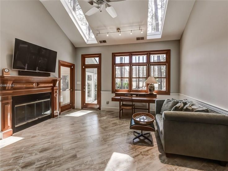 The 25 best craftsman ceiling fans ideas on pinterest best craftsman living room with hardwood floors high ceiling ceiling fan metal fireplace aloadofball Choice Image