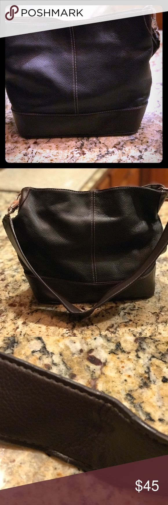 Tignanello Handbag Black and brown Tignanello Handbag with silver hardware. Good condition. Only flaw is on the middle of the strap where it was hung on a hook. Perfect size for every day. Tignanello Bags Shoulder Bags