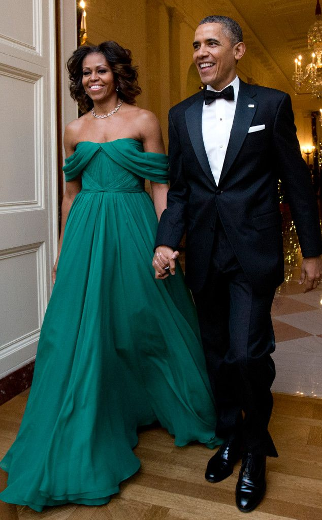 Michelle Obama glows in an emerald silk chiffon Grecian gown by Marchesa. #fashion
